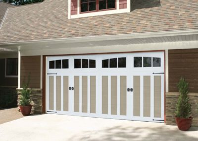 Chariot Court Bama Design with 3 Lite Arched Windows and Canterbury Decorative Hardware in Sandtone/White